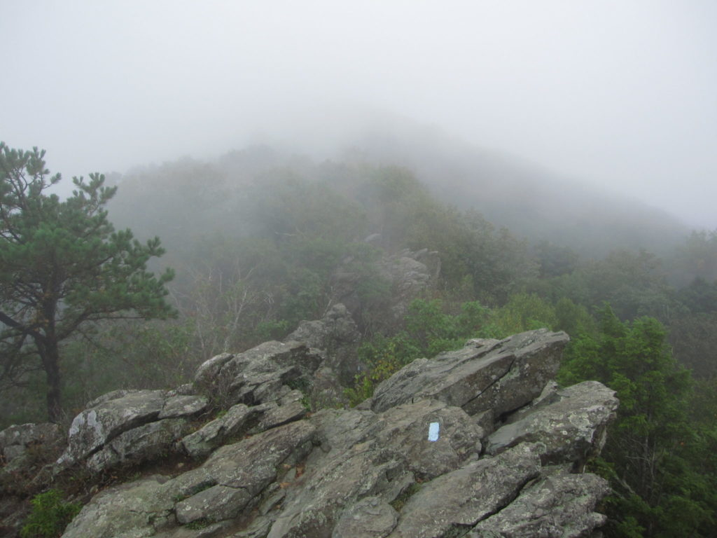 Thick fog near the peak of the rock scramble - You can see the ridge we followed in the distance