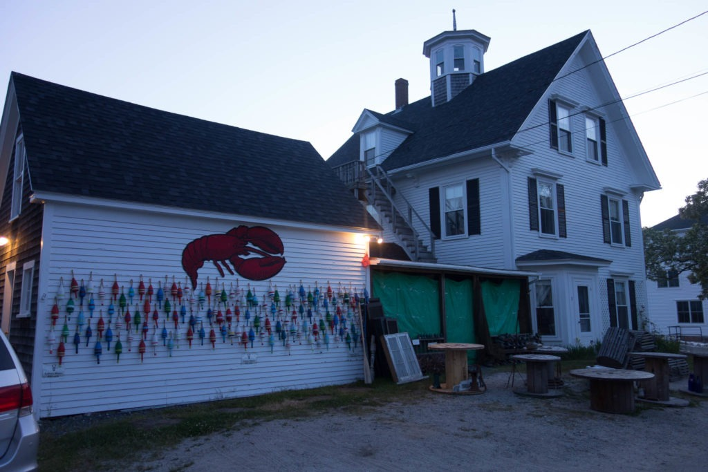 Acadia: Lobster Buoys on Wall in Stonington
