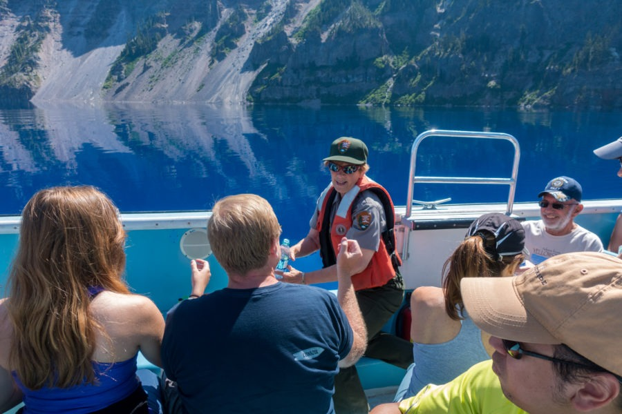 Crater Lake: Park Ranger Filling Water Bottles from the Lake