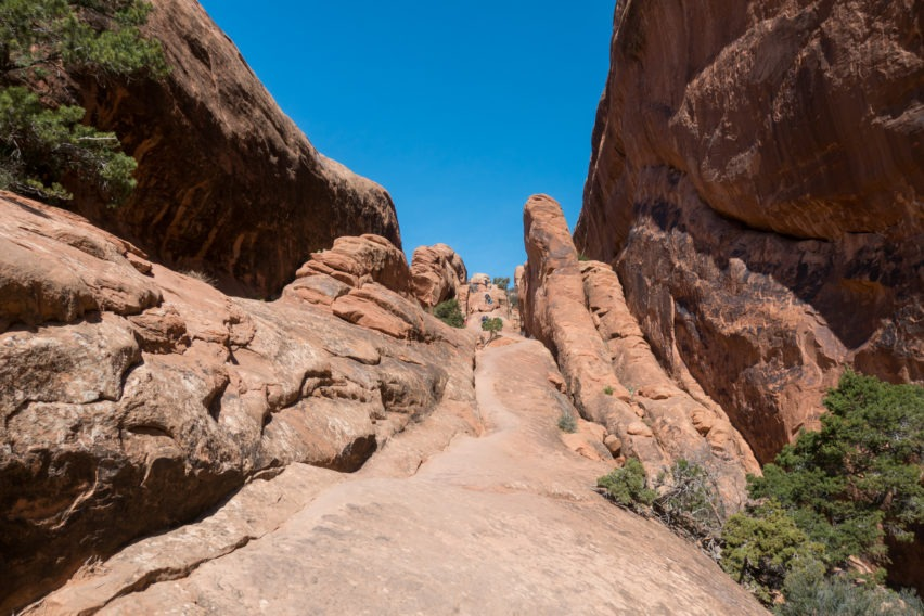 Arches: Heading up Sandstone Fin on Devils Garden Trail