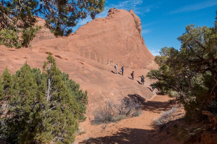 Arches: Slickrock Ascent on Private Trail in Devils Garden
