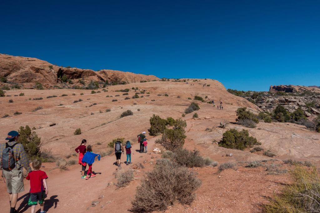 Arches: Ascending Sandstone Slope to Delicate Arch